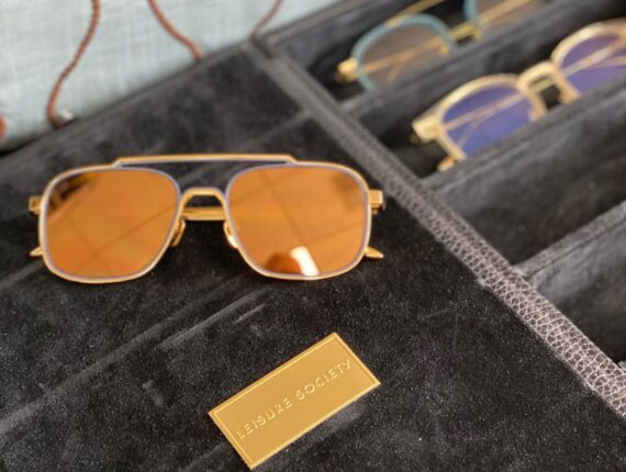 Gold Mirrored Sunglasses on Black Felt Tray