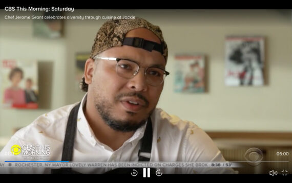 Screenshot of chef Jerome Grant talking to CBS interviewer at Jackie restaurant